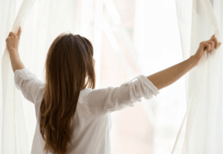 A woman ventilating her room